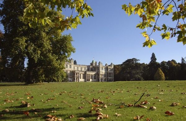 AUDLEY END HOUSE AND GARDENS, Essex. View across the lawn towards the house showing the Autumn leaves