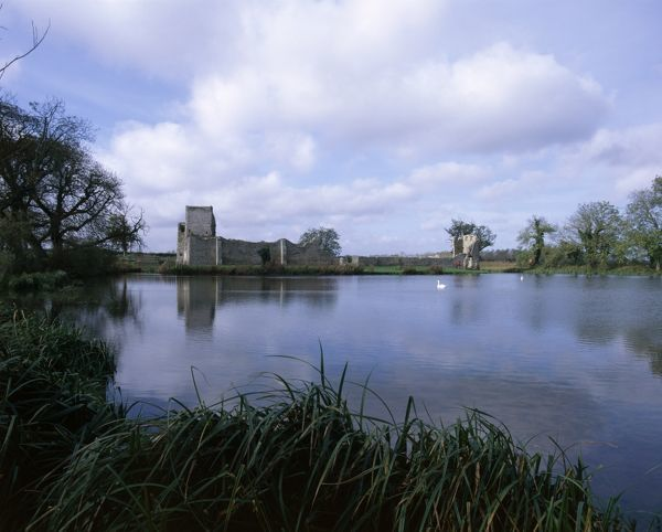 BACONSTHORPE CASTLE, Norfolk. View of the castle from the east with mere (lake) in foreground