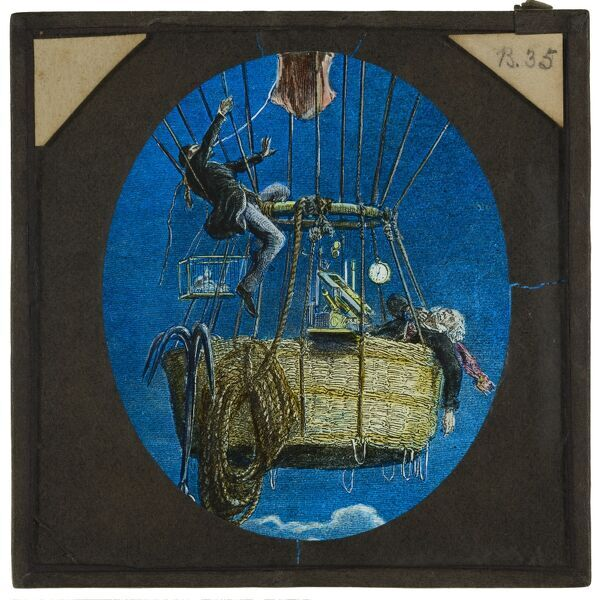 Tales of balloon flight. A hand-coloured engraving of James Glaisher and Henry Coxwell in the basket of a gas balloon during their ascent to c.10000 feet in 1862. Coxwell is pulling the rip cord, Glaisher is unconscious from the lack of oxygen