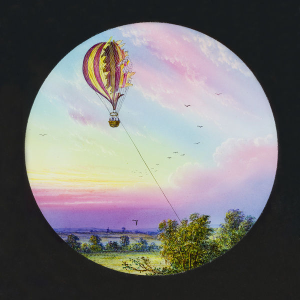 Tales of balloon flight. Hand-coloured engraving showing French balloonist Jules Durouf's gas balloon 'Le Neptune' exploding during a tethered flight in 1860