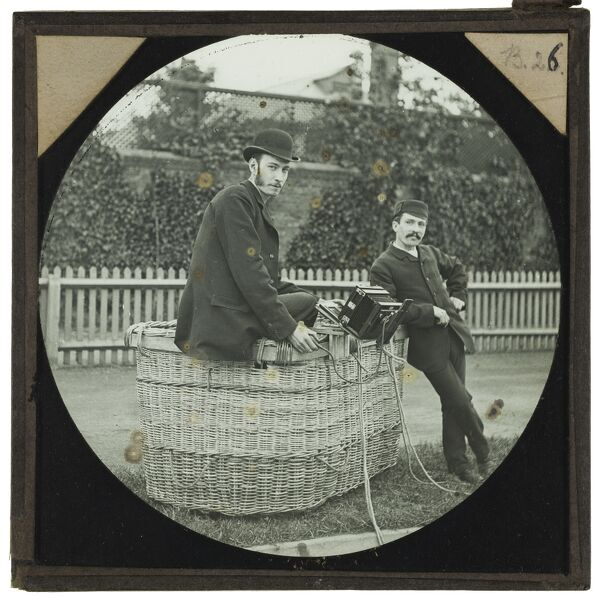 Tales of balloon flight. Intrepid balloonists Cecil Shadbolt (left) and 'Captain' William Dale (right) posed in the basket of a gas balloon. Shadbolt's camera can be seen, attached to the side of the basket. On 29th June 1892, Shadbolt