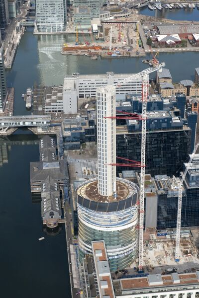 Baltimore Tower, Isle of Dogs, Tower Hamlets, London. The tower under construction in March 2015. The design has been nicknamed The Slinky. A residential skyscraper on a site occupied between 1989 and 2006 by the London Arena