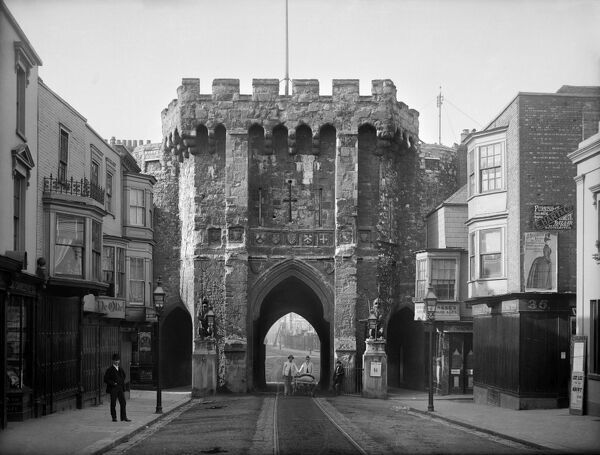 BARGATE, Southampton, Hampshire. Exterior view looking south through the medieval gatehouse at the northern entrance to the town. Workmen pose with their cart in front of the gate. Photographed in 1885 by Henry Taunt