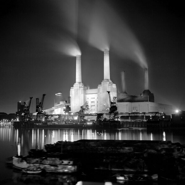 BATTERSEA POWER STATION, London. View from the north bank of the River Thames at night. It was designed by Sir Giles Gilbert Scott in 1937 and was the largest brick building in europe. Photographed by Eric de Mare. Date range 1955-1980