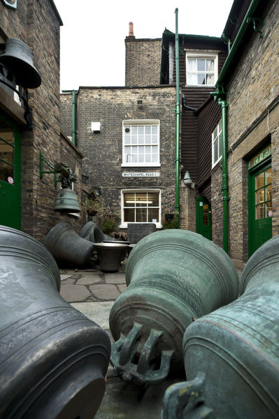 Whitechapel Bell Foundry, 32-34 Whitechapel Road, Tower Hamlets, London. Exterior showing bells in the courtyard. The foundry has been operating on these premises since 1739, casting both the Liberty Bell and Big Ben here