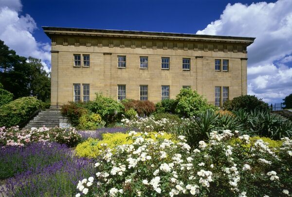 BELSAY HALL & GARDENS, Northumberland. Garden (south) front of Belsay Hall with flower beds in foreground