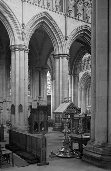 BEVERLEY MINSTER, East Yorkshire. Interior view. A view looking across the nave with the lectern in the foreground and the pulpit in the background. Beverley Minster is a large and beautiful church dating from the mid-13th to 14th centuries