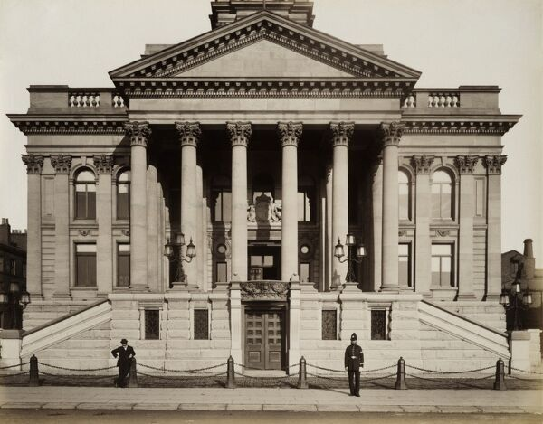 BIRKENHEAD TOWN HALL, Hamilton Square, Birkenhead, Merseyside. Exterior of Birkenhead Town Hall showing the portico. A policeman and by-stander look to camera. Photographed by Harry Bedford Lemere, 9th June 1888