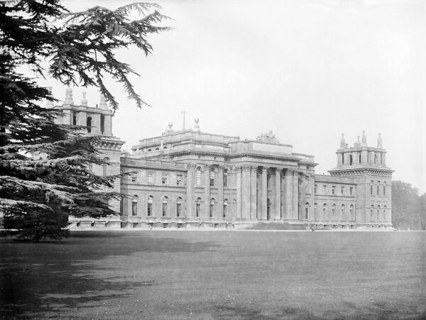 BLENHEIM PALACE, Woodstock, Oxfordshire. Looking along the south front of the 18th century palace from the west, showing the central portico supported on columns and the lawn in the foreground. Photographed in 1912 by Henry Taunt.