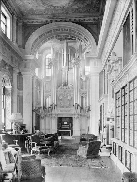 BLENHEIM PALACE, Woodstock, Oxfordshire. Interior view. The beautiful organ standing at one end of the Long Library, installed by the eighth Duke in 1891. The library is decorated with stucco work and hung with portraits of the Royal Family