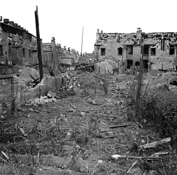 LONG ACRE, Nechells, Birmingham, West Midlands. The rear of Long Acre and Crompton Road showing bomb damage which included a direct hit on a shelter. Photographed by James Nelson, 29th July 1942