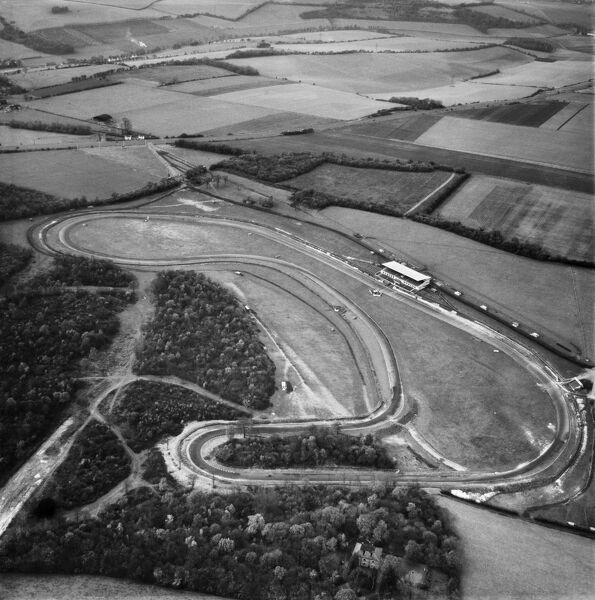 Brands Hatch racing circuit, Swanley, Kent. Photographed here in November 1955, five years after the introduction of the first tarmac surface. In the foreground are Druids with Paddock Hill to the right, and the newly installed Grandstand on the pit straight