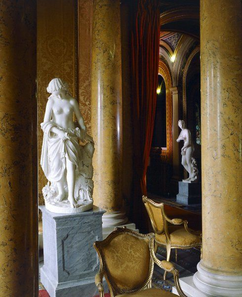 BRODSWORTH HALL, South Yorkshire. Interior view of statues, chairs and pillars in the South Hall