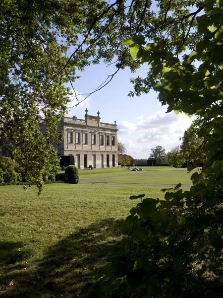 BRODSWORTH HALL AND GARDENS, South Yorkshire. View of the house through the trees taken from the North West
