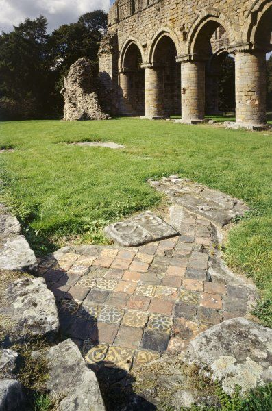 BUILDWAS ABBEY, Shropshire. Tiles and grave slabs on the south chapel floor