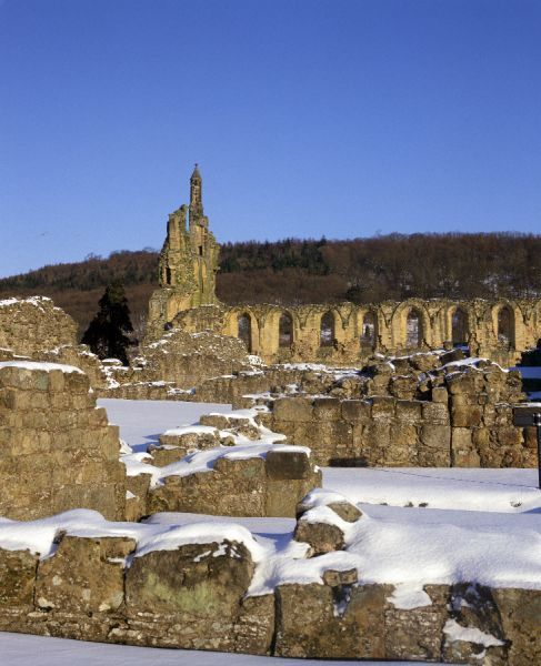 BYLAND ABBEY, North Yorkshire. View northwards towards the ruined church in the snow