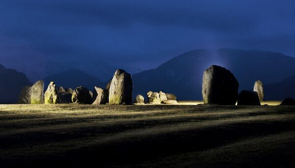 CASTLERIGG STONE CIRCLE, Cumbria. Illuminated view of the stones