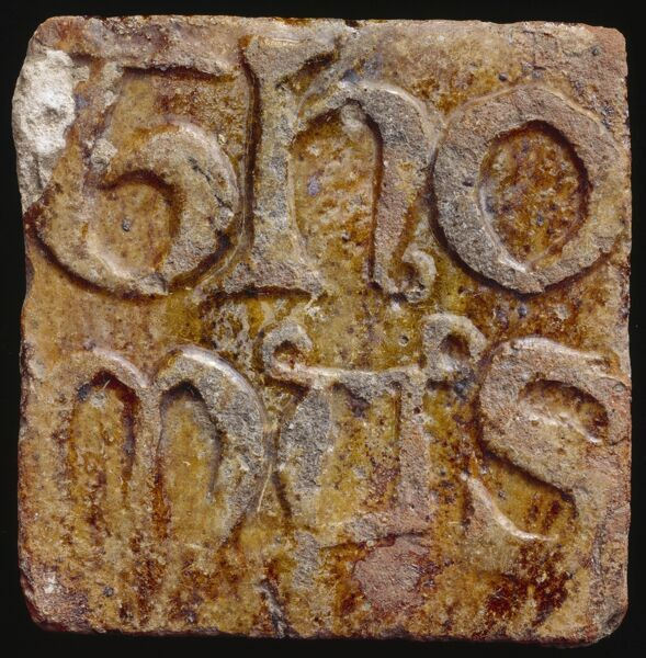 CASTLE ACRE PRIORY, Norfolk. A decorative ceramic tile bearing the name Thomas, a prior at Castle Acre Priory during the second half of the 14th century