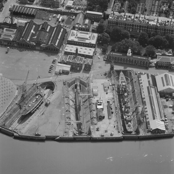 Chatham Naval Dockyard, Kent. This aerial photograph shows the dry docks at Chatham Dockyard beside the River Thames. The site was first used in 1547, but its busiest period was in the 19th century when 2 ships every year were being launched