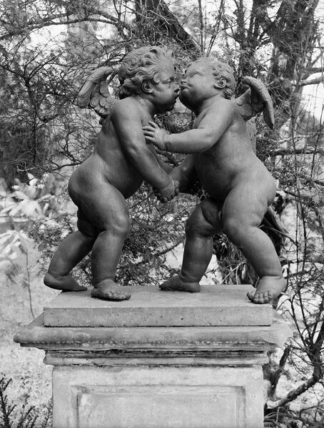 "MELBOURNE HALL, Derbyshire. Lead garden figures on a plinth entitled ""Cherubs reconciliation"". Photographed in 1954 by G B Mason for the National Buildings Record"