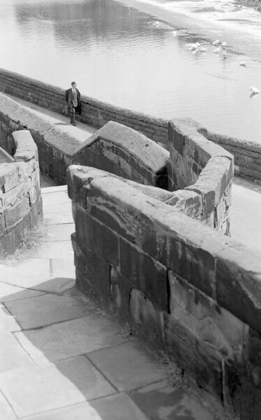 CHESTER CITY WALLS, Cheshire. The medieval city wall of Chester is the most complete in England. The walls date mostly from the 13th-century, though they are much repaired. Here a flight of 18th-century steps leads down from the wall to the River Dee