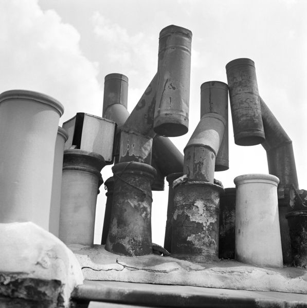 Detail of chimney pots, in Islington or Camden. Photographed by John Gay. Date range: 1960 - 1965