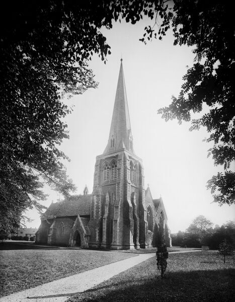 HOLY TRINITY CHURCH, Cirencester, Gloucestershire. The church exterior from the north-west. Made from Forest Marble and with a stone roof, it was designed by Sir George Gilbert Scott and built in 1850-1. Photographed in 1890 by Henry Taunt