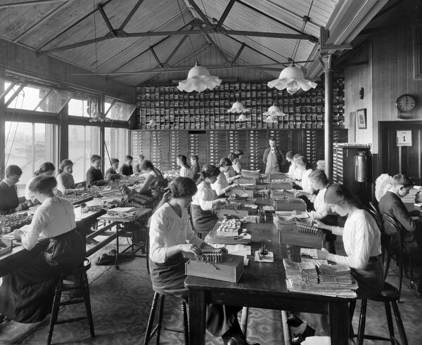 STRATFORD CO-OPERATIVE SOCIETY, Maryland Street, Stratford, Greater London. Interior view of the Comptometer Room at Stratford Co-operative Society, showing girls and boys working on model 'E' compometers, manual calculating machines