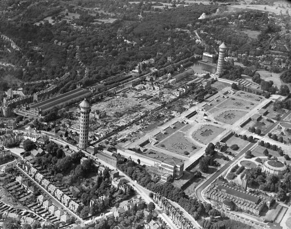 Crystal Palace, Sydenham, London. A catastrophic fire destroyed most of the building in November 1936. Brunel's water towers were still standing until they were demolished during the Second World War. Aerial view by Aeropictorial. Aerofilms Collection