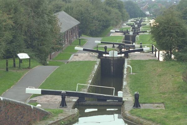 "A closely-spaced flight of narrow locks on the Stourbridge Canal. Known locally as ""Nine Locks"" although only eight now remain. IoE 217976"