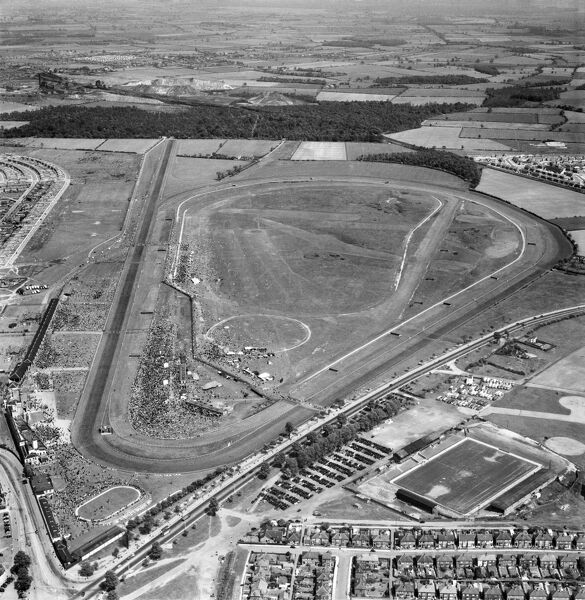 DONCASTER RACECOURSE. Aerial view of the racecourse with a meet in progress. Belle Vue, home of Doncaster Rovers Football Club, is adjacent in the foreground. Photographed in May 1953. Aerofilms Collection (see Links)