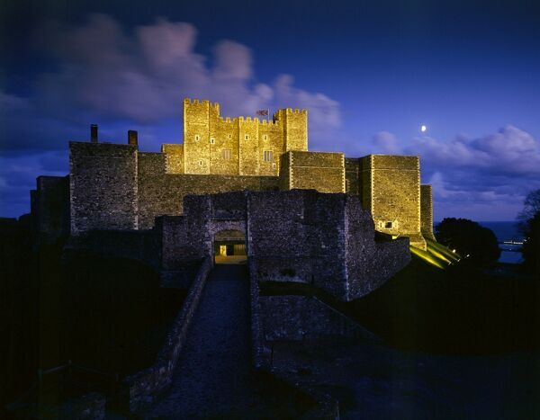 DOVER CASTLE, Kent. Illuminated view of castle from the North West at night