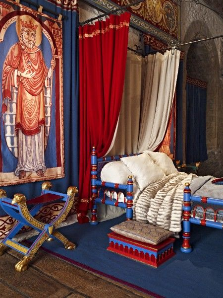 DOVER CASTLE, Kent. Interior of the King's Chamber in the Great Tower showing replica bed, chair and furnishings