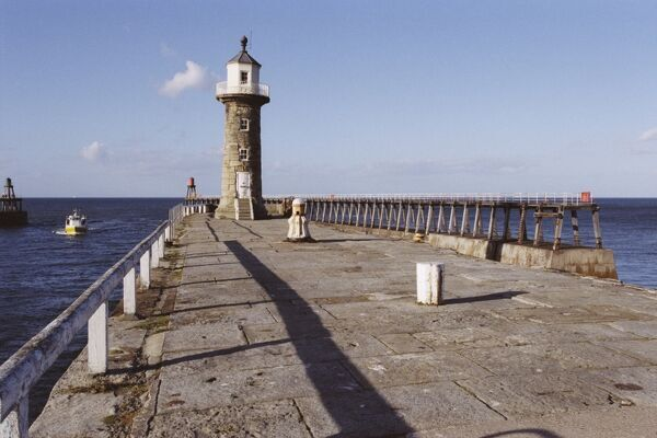Picturesque shot of the lighthouse at Whitby, North Yorkshire. IoE 437029