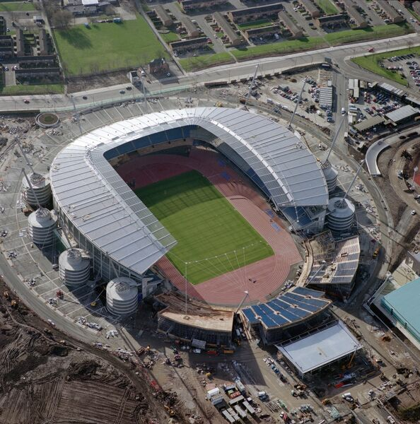 CITY OF MANCHESTER STADIUM also known as Eastlands, home to Manchester City Football Club since August 2003. Seen here under construction in February 2002, it was first used as the venue for the 2002 Commonwealth Games. It was then redeveloped