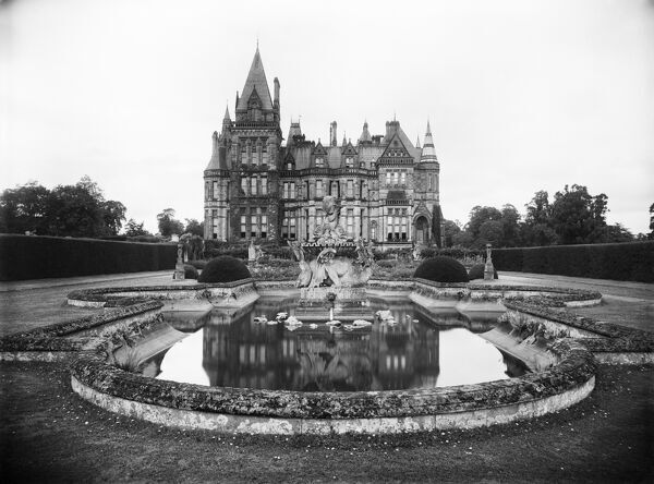 Eaton Hall, Cheshire. The Dragon Fountain in the Italian Garden, with the south elevation of the house behind