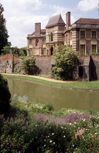 ELTHAM PALACE, Greenwich, London. View looking over the rockery and moat towards the house
