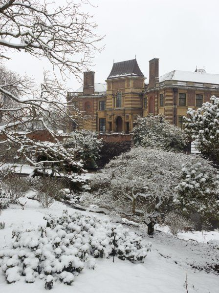 ELTHAM PALACE, London. View across the moat looking towards the house in the snow
