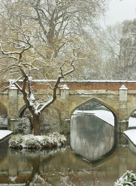 ELTHAM PALACE, London. View of the moat and the medieval stone bridge in the snow