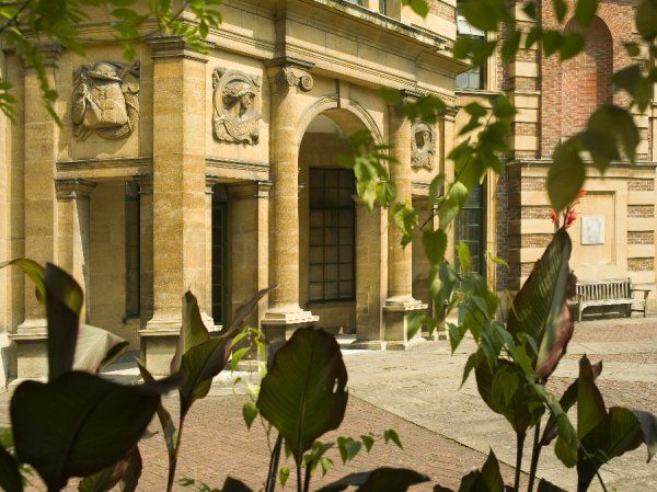 ELTHAM PALACE, Greenwich, London. A view of the loggia through foliage