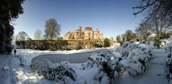 ELTHAM PALACE, London. Panoramic view towards the frozen moat showing the house and snow covered gardens