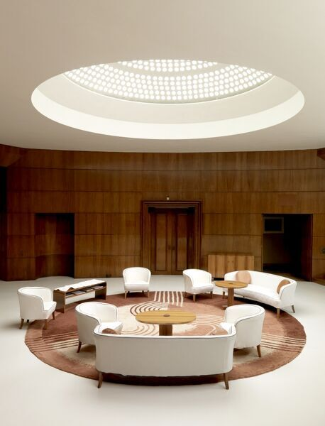 ELTHAM PALACE, London. Interior view. Light filters down from the glass domed roof illuminating the Entrance Hall