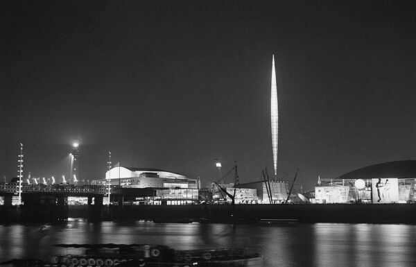 Festival of Britain, South Bank, Lambeth, London. A nightime view across the Thames looking towards the South Bank Exhibition site during the Festival of Britain showing Skylon illuminated. Photographed by John Frederick Physick in 1951
