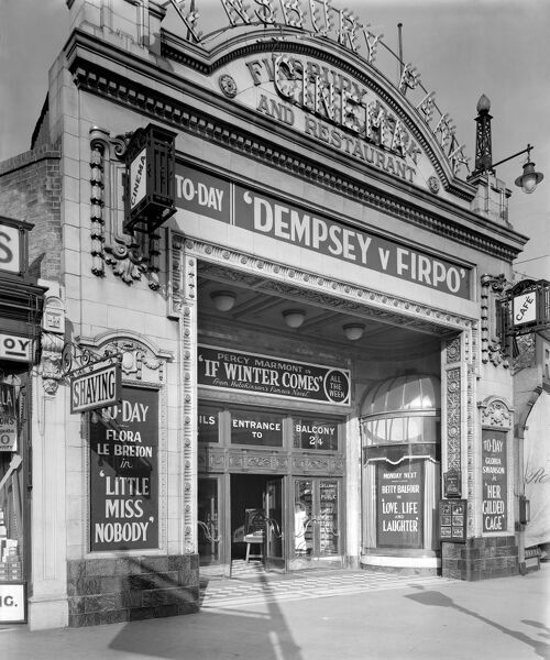 FINSBURY PARK CINEMA, London. An exterior view of the entrance to Finsbury Park Cinema advertising a varied programme, including a film of the heavyweight boxing bout between Jack Dempsey and Luis Angel Firpo fought on 14th September 1923