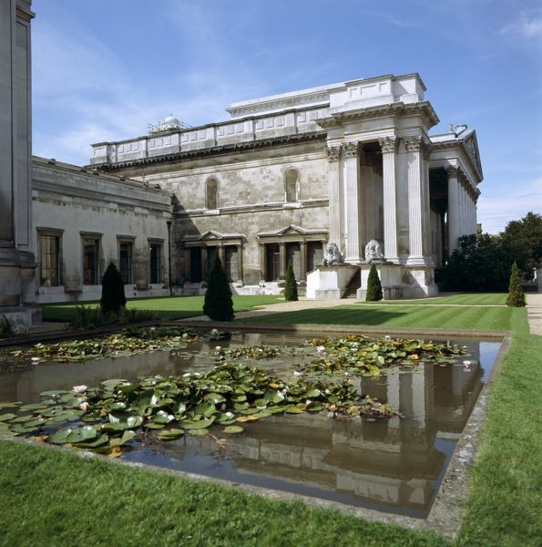 FITZWILLIAM MUSEUM, Cambridge. Exterior view with pond in the foreground