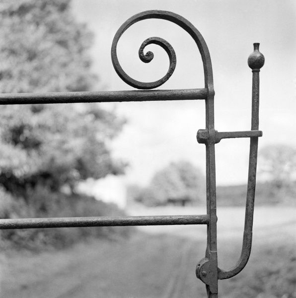 Detail view in an unidentified location showing a wrought iron farm gate latch. Photographed by Eric de Mare between 1945 and 1980