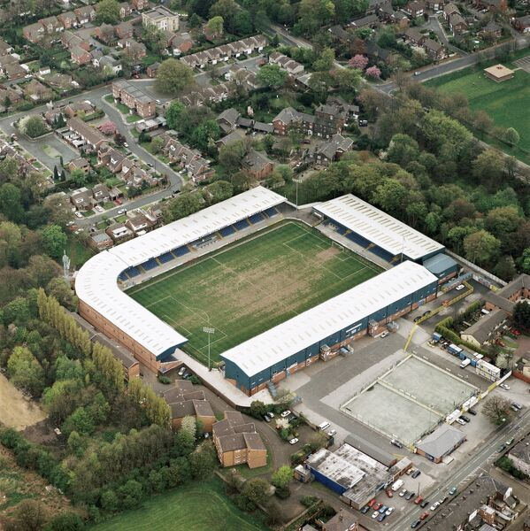 GIGG LANE, Bury. Home of Bury Football Club - The Shakers. Photographed in April 2000. Aerofilms Collection (see Links)