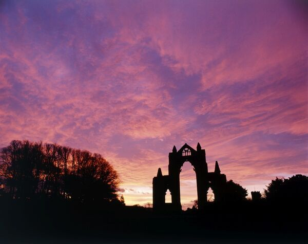 GISBOROUGH PRIORY, Guisborough, Redcar and Cleveland. The sun sets at Guisborough producing a dramatic silhouette of the priory