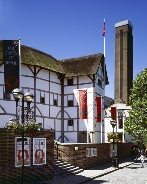 SHAKESPEARE'S GLOBE THEATRE, Bankside, London. General view of the theatre with the chimney of Tate Modern beyond