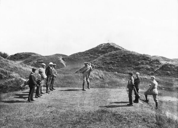 Burnham And Berrow Golf Course, St Christopher's Way, Burnham-On-Sea, Somerset. Golfers and caddies watching a figure drive a shot towards Majuba Hill. Photographed in June 1898 for the London Midland and Scottish Railway